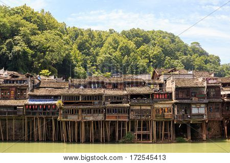 Photo of Historic Asian Village. Wooden Houses Above the Water. Trasitional Chinese Architecture Wood Buildings