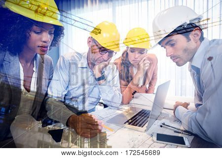 Crane and building construction site against architects discussing blueprints in meeting
