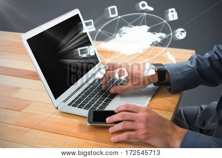 Cropped image of businessman using laptop against black
