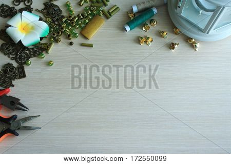 green color handmade accessories making tools on the table