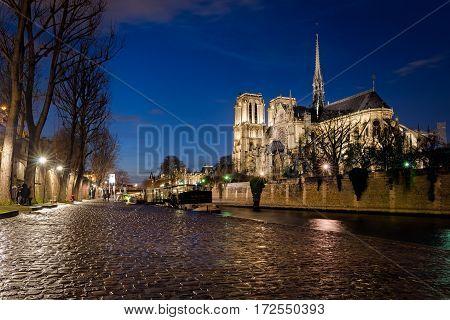 Notre-Dame de Paris and Seine river at blue hour