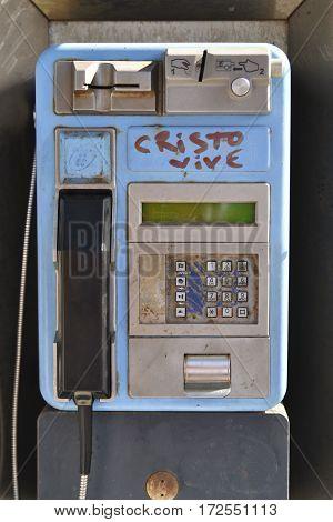 Modern well-worn payphone with graffiti from town Puerto de la Cruz Tenerife Spain.