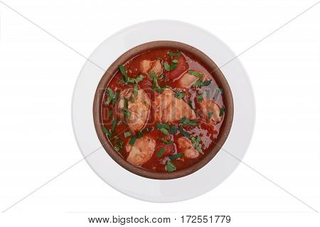 chakhokhbili fried chicken in tomato sauce traditional Georgian dish white background top view