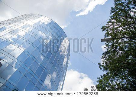Sky reflected building glass facade. The glass facade
