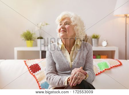 Grandma smiling and daydreaming about her youth