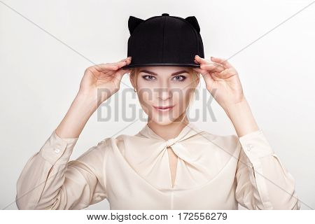 portrait of beautiful young blond sexy woman in hat cat. cat woman