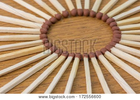 matches on the table in the form of the sun close-up with shallow depth of field