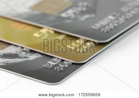 fragment of a stack of three credit cards with a focus on near card