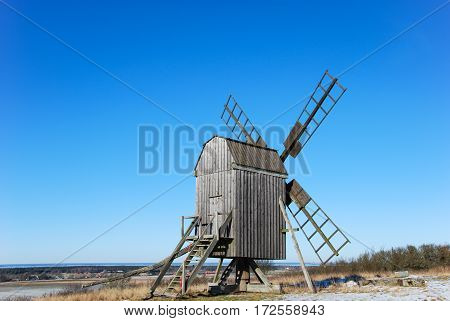 Old wooden windmill on a hill at the swedish island Oland the island of sun and wind in the Baltic Sea. Windmills are typical symbols for the island Oland.