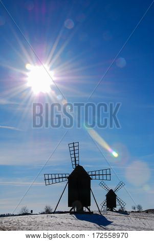 Two old wooden windmills in bright sunshine at the swedish island Oland