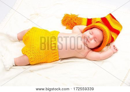 A cute newborn baby girl sleeping. Sweet little baby portrait. Use the photo to represent life parenting or childhood