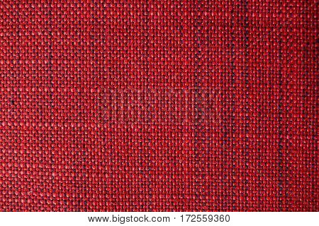 Red fabric texture. Red cloth background. Close up view of red fabric texture and background. Abstract background and texture for designers.