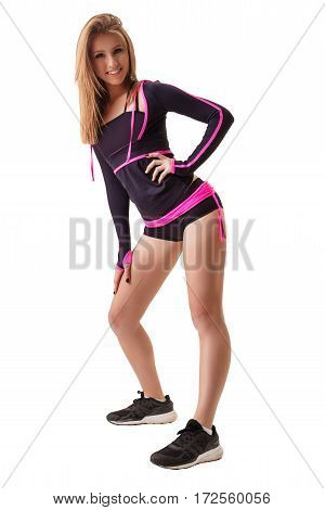 Sexy blonde in nice violet and pink sporty longlsleeve and shorts posing slenderly in studio