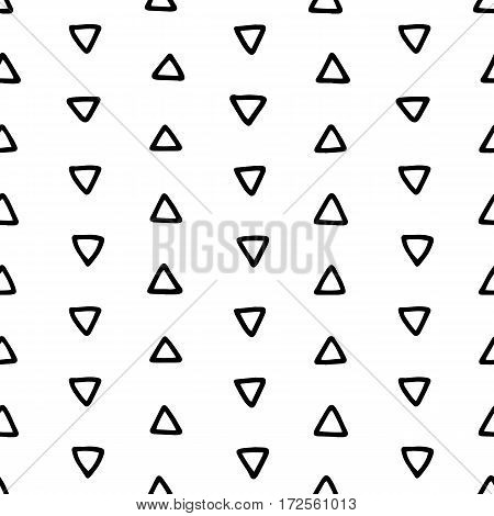 Seamless hand drawn geometric tribal pattern with triangles. Vector navajo design illustration.
