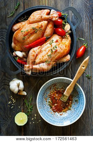 Preparation for roasting chicken with herbs and spices.