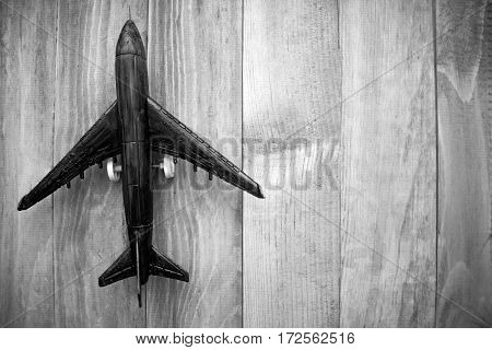 plane on a wooden background, top view