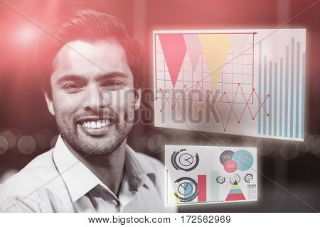 Graph against happy businessman in office