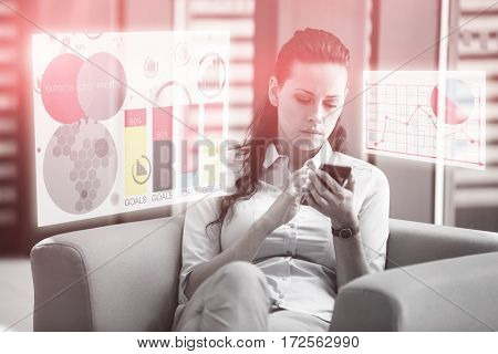 Digital generated image of multi colored graph charts against businesswoman sitting and using mobile phone