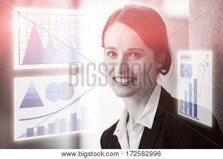 Graph against smiling businesswoman in office