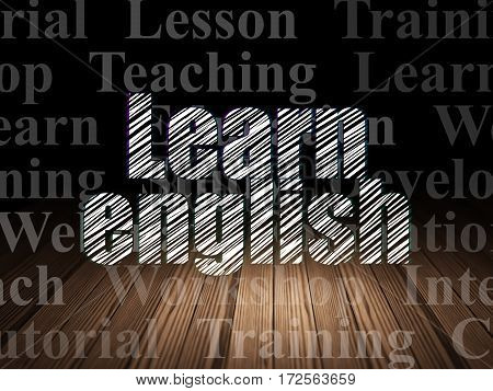 Education concept: Glowing text Learn English in grunge dark room with Wooden Floor, black background with  Tag Cloud