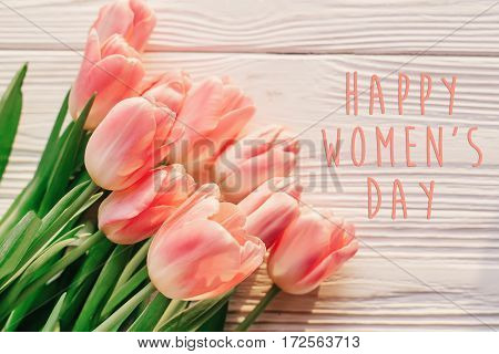 Happy Women's Day Text On Pink Tulips On White Rustic Wooden Background. Greeting Card Concept. Sens