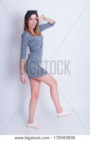 Photo of young active woman. Girl posing. Studio photo.