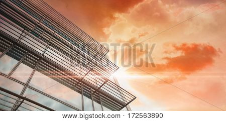 Sunrise over magical sea against low angle of office building
