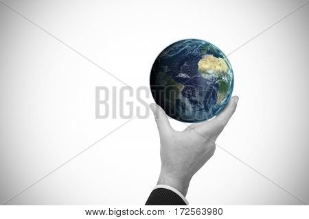 Businessman pointing with his finger against digitally genearated image of earth