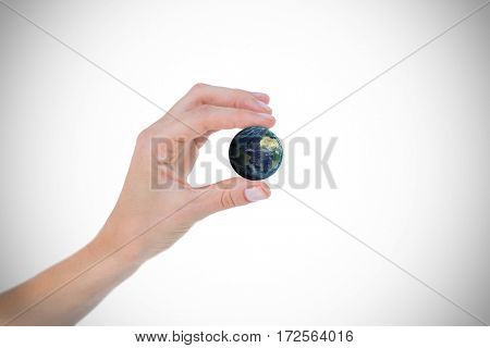 Woman presenting with her hand against digitally genearated image of earth