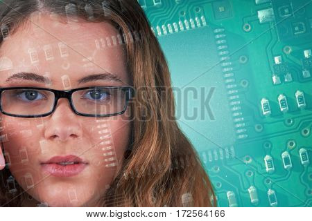 Portrait of beautiful woman wearing spectacles against green and black electronic circuit