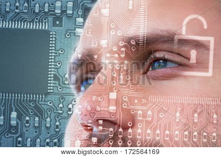 Man with green eyes against lock in circuit board
