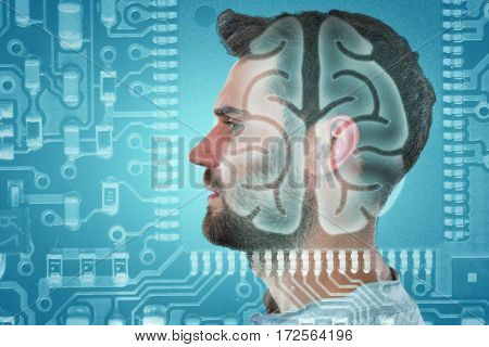 Profile of a handsome man against human brain in circuit board