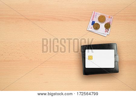 Credit card mock-up wallet and money on table
