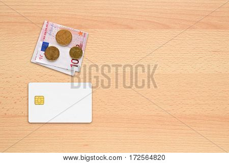 Credit card mock-up and money on table