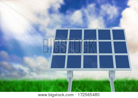Solar panel against green grass under blue sky
