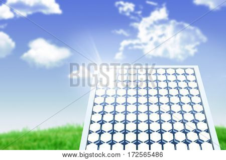 Hexagon solar panel equipment against white screen against blue sky over grass
