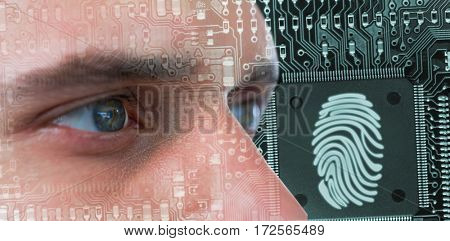 Man with green eyes against thumb print in circuit board