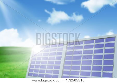 Solar panel against white screen against blue sky over green field