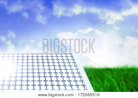 Solar equipment in hexagon shaped against field of grass under blue sky