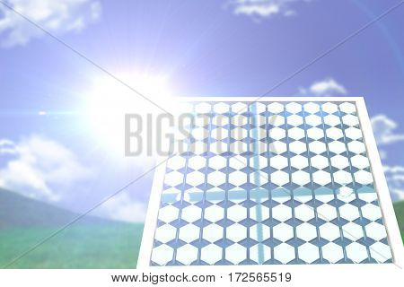 Solar panel with hexagon shape against grass and sky