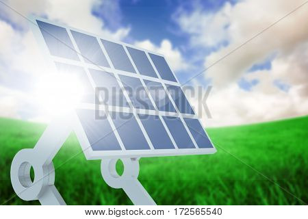 Sources of renewable energy equipment against green field under blue sky