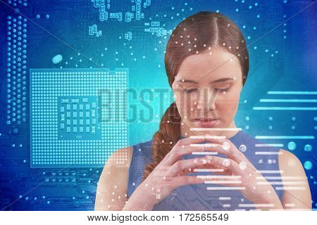 Thoughtful beautiful woman against micro parts in computer chip
