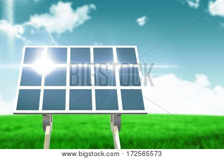 Blue solar panel against blue sky over green field