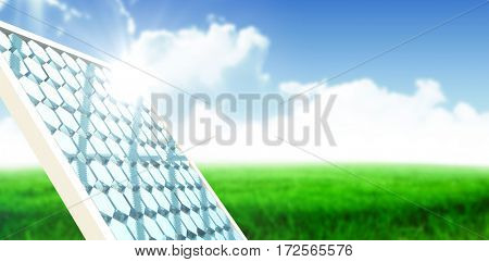 Digitally generated image of solar panel with hexagon shape glasses against blue sky over green field