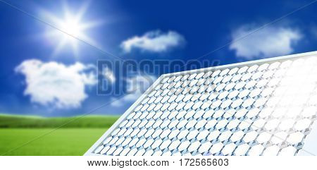 Digitally generated image of solar panel equipment against sunny green landscape