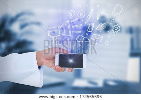 Male doctor holding smart phone with blank screen against composite image of an office