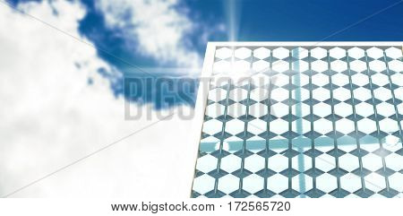 Solar panel with hexagon shape against low angle view of sky