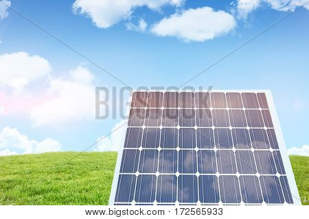 Hexagon solar panel equipment against blue sky over green field