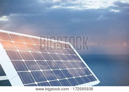 Illustration of solar panel equipment against scenic view of seascape against cloudy sky