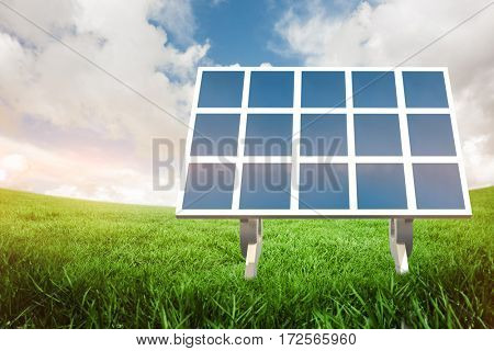 Blue solar panel against green field under blue sky